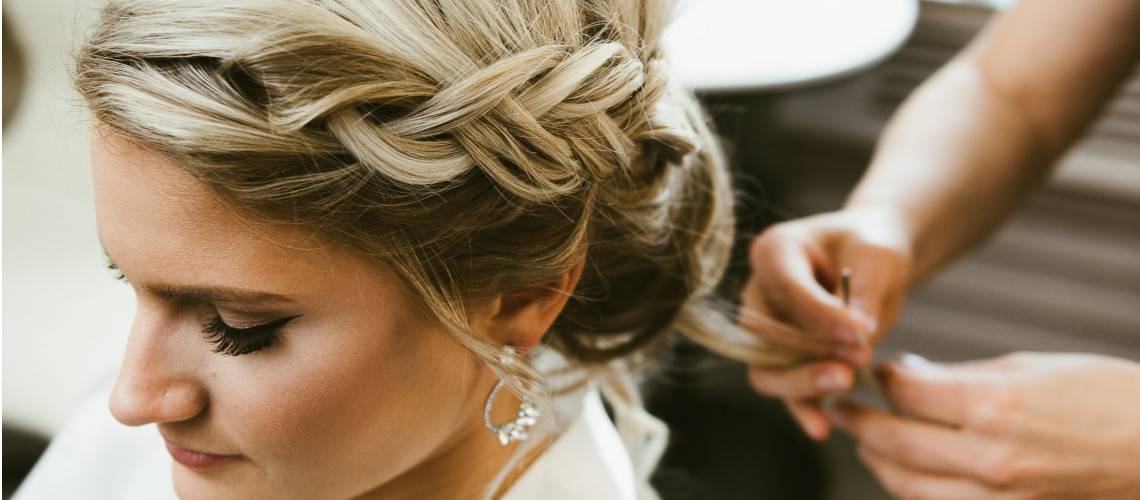 Bride getting her hair styled