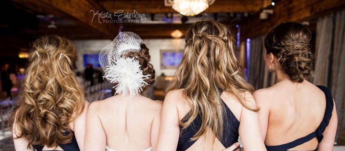 Bride and bridesmaids looking over reception hall